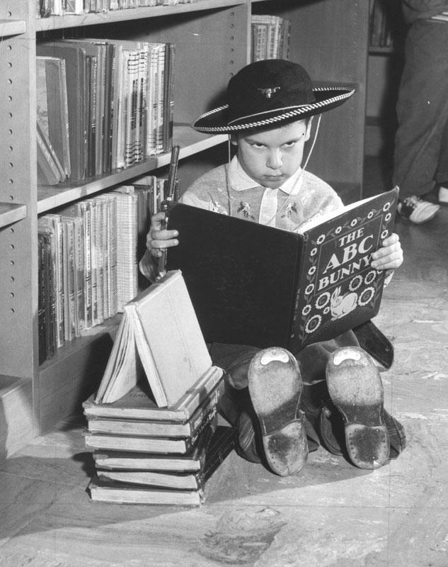 La Library 1960 Gun Toting Child Reads Bunny Book