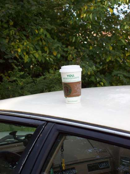 Guy Mounts Coffee Cup On Car Roof Tweets About Peoples