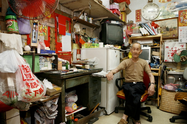 Photographs Of Residents In Their Tiny Flats In Hong Kong