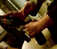 Opening a beer bottle with another beer bottle