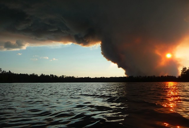 Photo of a fire over a lake
