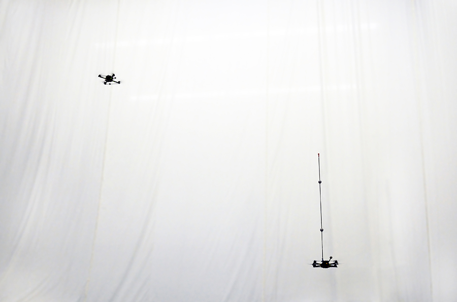 Drones toss and catch inverted pendulum