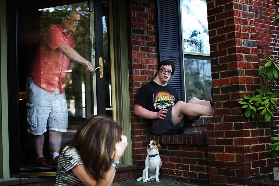 Jamie and his parents, Michael Berube and Janet Lyon, wait on the front porch for his Person/Family Directed Support companion to arrive to go to dinner with him. Due to a mix-up in scheduling, she was unable to make it. Jamie's parents are open and honest in discussing disappointments and negative feelings with Jamie, and they encourage him to express himself and his feelings in a constructive and communicative way.