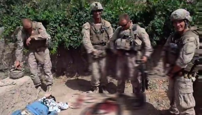 A still from a 2011 video posted online that showed Marines urinating on dead bodies. [Reuters]