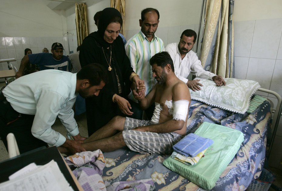"DATE IMPORTED:September 20, 2007A man who was wounded in a shooting attack by the security guards of Blackwater firm on Sunday, is helped by his relatives in a hospital in Baghdad, September 20, 2007. Iraqi Prime Minister Nuri al-Maliki suggested on Wednesday the U.S. embassy stop using American security firm Blackwater after a deadly shooting, saying he would not allow Iraqis to be killed in ""cold blood"". REUTERS/Ceerwan Aziz (IRAQ)"
