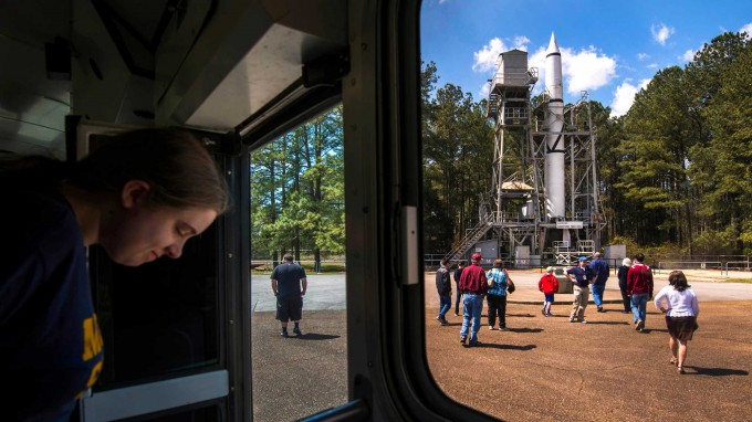 Visitors on a bus tour from the U.S. Space & Rocket Center make a stop at the historic Redstone test site, a National Historic Landmark at the NASA Marshall Space Flight Center, on Wednesday, April 9, 2014, in Huntsville, Ala.( Smiley N. Pool / Houston Chronicle )