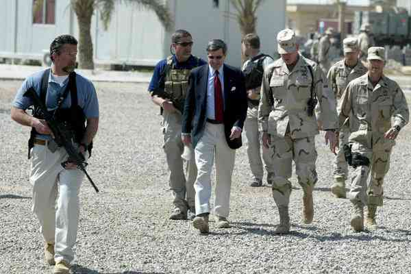 Blackwater personnel escorting Paul Bremer, an American civil administrator, upon his arrival in Ramadi, Iraq, in March 2004. [Reuters]