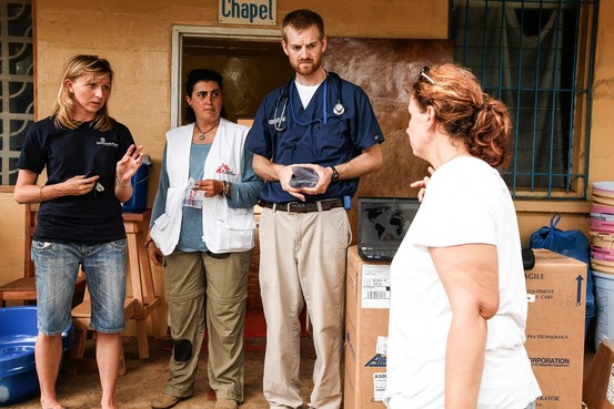 Kent Brantly, a doctor who contracted Ebola in Liberia, shown with colleagues in this undated photograph provided by Samaritan's Purse. Samaritan's Purse//Reuters