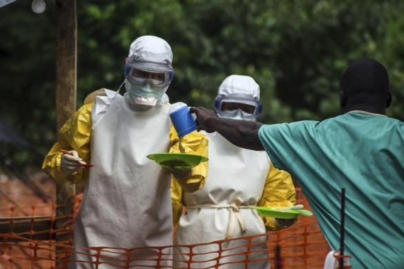 Medical staff working with Medecins sans Frontieres (MSF) prepare to bring food to patients kept in an isolation area at the MSF Ebola treatment center in Kailahun, Sierra Leone July 20, 2014. REUTERS/Tommy Trenchard