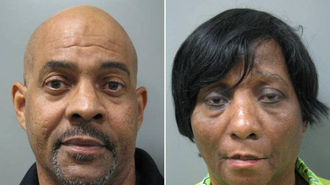 John Land and Janice Land.  Booking photos via Montgomery County, MD, police.  They are reported to have kept their autistic, twin adult sons locked up at night in their basement, which lacks a bathroom.