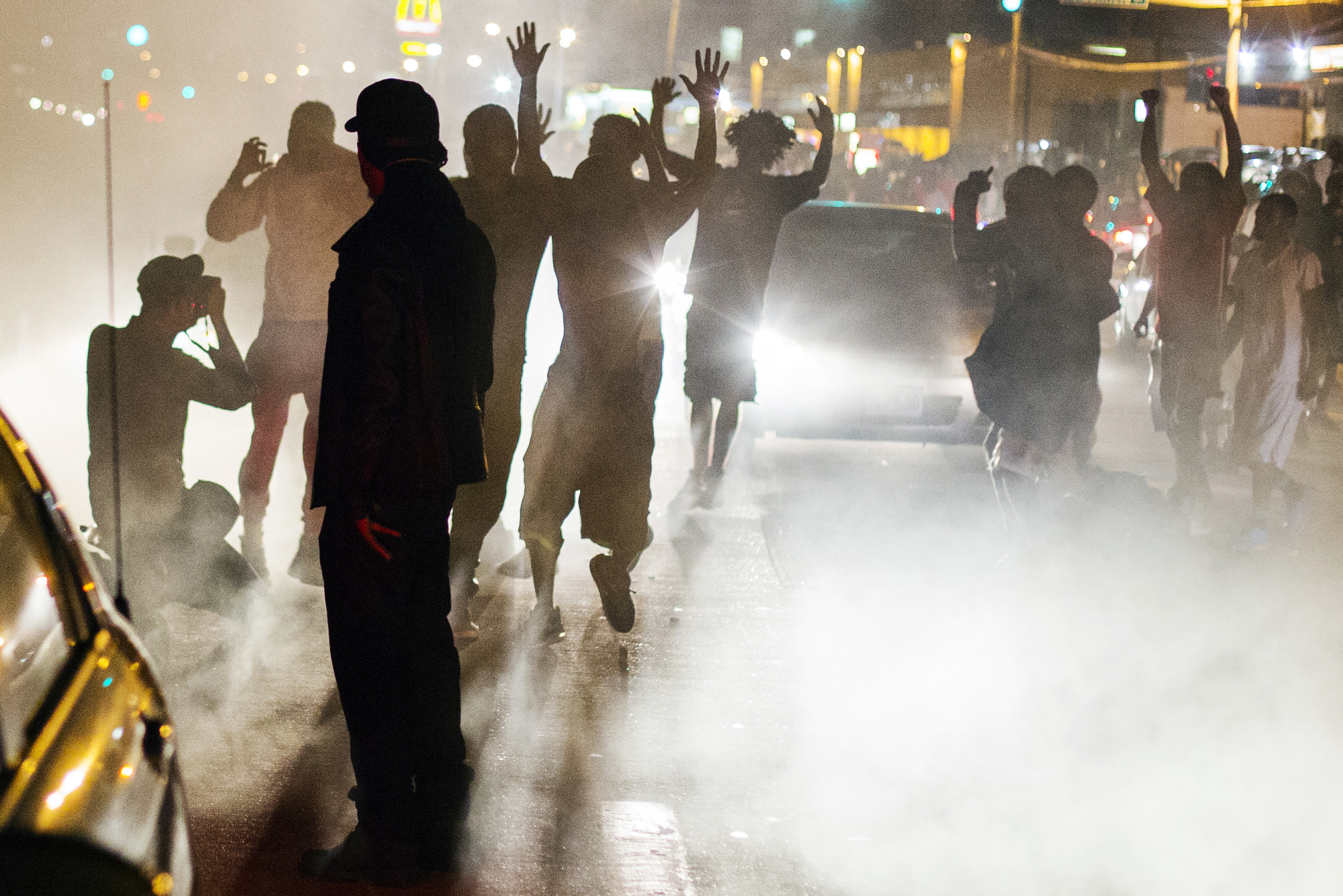 Protesters chant during a peaceful demonstration as communities continue to react to the shooting of Michael Brown in Ferguson, Missouri