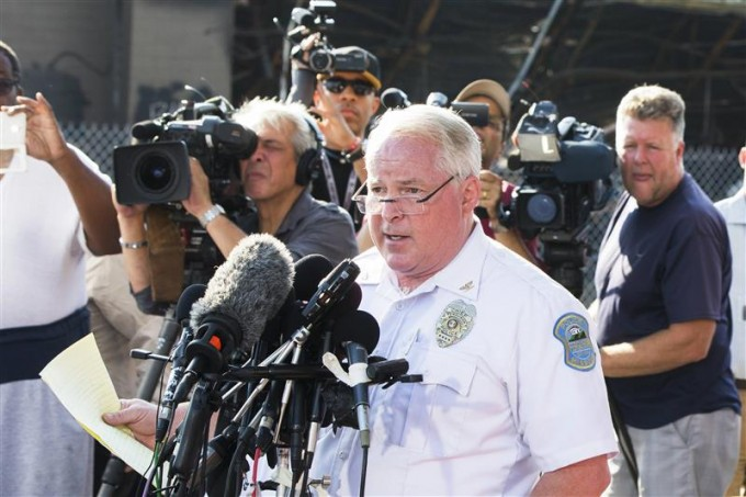 Ferguson Police Chief Thomas Jackson announcing the name of the officer. [REUTERS/Lucas Jackson]