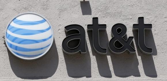 An AT&T logo is seen atop a store in Beverly Hills, California August 31, 2011. [REUTERS/Danny Moloshok]
