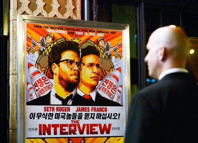 A security guard stands at the entrance of United Artists theater during the premiere of the film ''The Interview'' in Los Angeles, California December 11, 2014. [REUTERS]