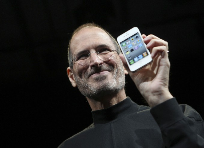 June 7, 2010: Apple CEO Steve Jobs poses with the new iPhone 4 during the Apple Worldwide Developers Conference in San Francisco, California. [Reuters]