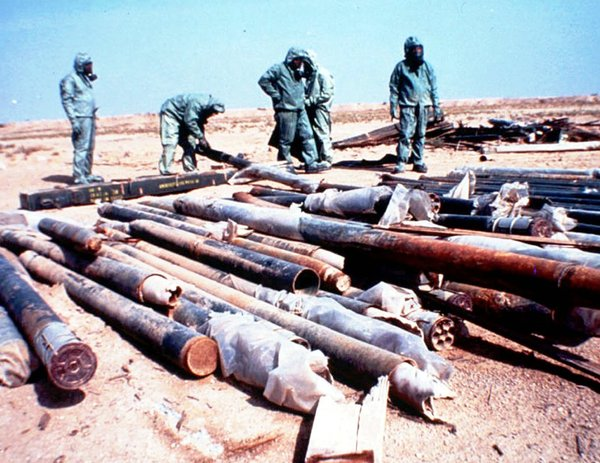 United Nations workers prepared for the destruction of Iraqi nerve-agent weapons by sealing leaks in the rockets. Photo: British Ministry of Defense