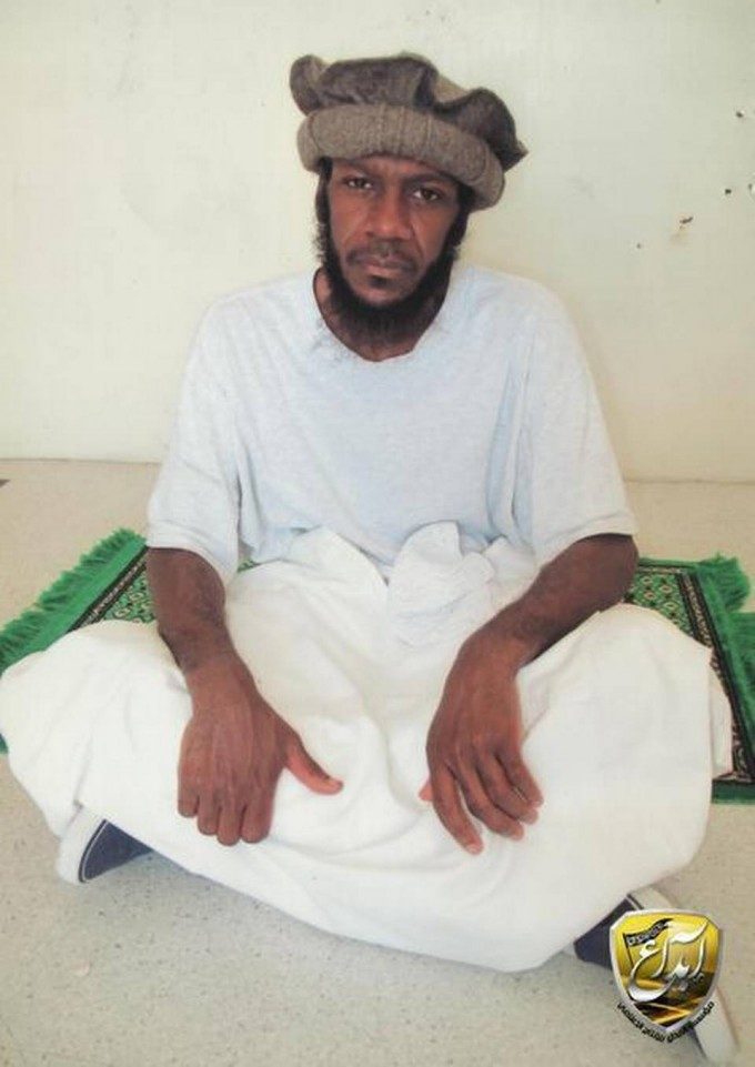 """Guantánamo prison photo of Saudi Mustafa al Hawsawi, accused of helping the 9/11 hijackers with funds and travel, turned up on Middle Eastern websites. He is seen sitting on a prayer rug and posing for the International Committee of the Red Cross in prison-approved images taken for family members."""